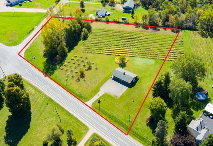 Ideal location for business use on the outskirts of 'downtown' Bangor. High visibility, exposure and seasonal traffic flow between Kalamazoo and South Haven. **Boundary lines are approximate**