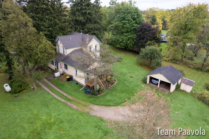 Charming farmhouse on 3 acres features barn with 950 finished sq feet. Perfect for home office, studio, exercise and more!