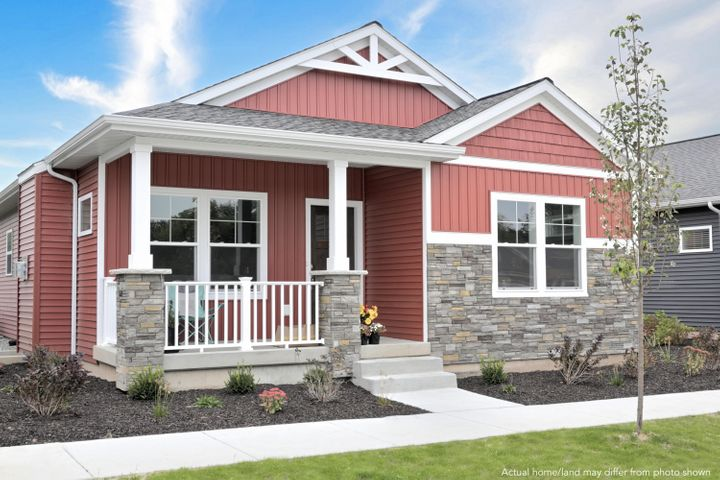 featured home will have white siding and grey stone