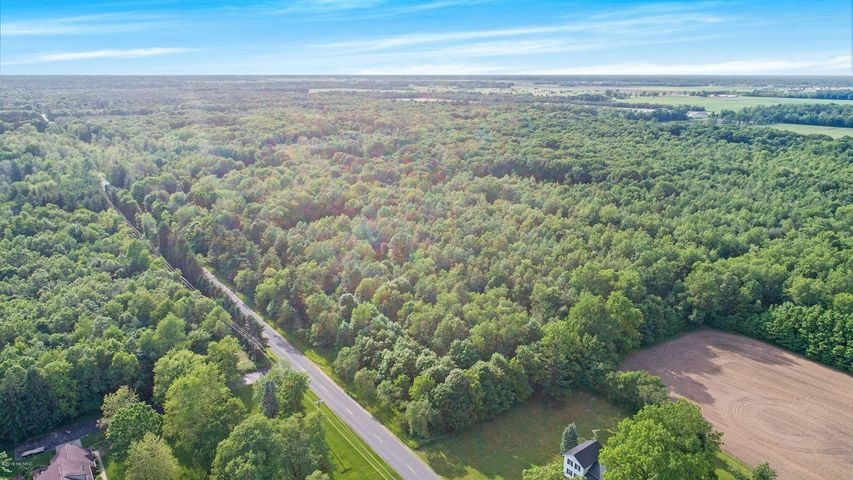DEVELOPMENT OPPORTUNITY or PRIVATE RETREAT! This 124 acre wooded property is on the market for the first time. The farmhouse is ready for renovation or restoration, the value is in the land and the home will be sold ''As IS'' all square footage is estimated. There are several parcels included in the sale: 701203200001, 701203100009,7012032000012, 701203200011,701203100025. The current owner would prefer to sell the property as a whole, but will consider offers on separate parcels. This beautiful property offers a creek, walnut trees and beautiful rolling terrain along with flat land. Call today for your private showing, let's go for a walk in your own private park!