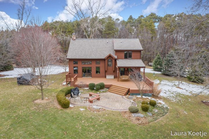 A dream come true. Situated on over 12 private and peaceful acres, the home you've waited for is here. This property provides a pleasant, comfortable setting along with 4 bedrooms, 2 1/2 baths and over 2,400 sq. ft. of finished living area.Tucked behind a thick grove of trees, sitting far off the road, with no neighbors behind, this custom-built and meticulously maintained home features updated kitchen and baths, a new mud room, and main floor laundry.The dramatic 2-story living room, overlooking the deck and acreage beyond, is kept cozy with a roaring fire in the newer Vermont Castings wood stove. After a long day--or lifetime--of work, this setting will rejuvenate your senses with a private pond, monarch habitat, prairie grasses, mature evergreens, open vistas, and breath-taking sunsets. Enjoy the option of heating the home almost exclusively with the wood stove with fuel provided by trees on the property; the propane forced-air furnace, or opt to hook up to natural gas which is available at the road.  The master suite features a bath with large shower, an incredible copper soaking tub, and a walk-in closet.  Other amenities include a 2 1/2 stall attached garage, storage shed, extra large deck, front porch, and full basement with 4th (non-conforming) bedroom, family room, and 2 unfinished storage areas, one with a Bilco door for easy access to the yard. Per the township, you can have a unlimited number of horses (or other livestock) here; an outbuilding here, along with the home, cannot exceed 25% of the total acreage area. You wouldn't settle for a cookie-cutter home or property.  This is the home for you.  Showings begin 3/7/20 at noon. Offers,  if received, not considered before 3/10/20.