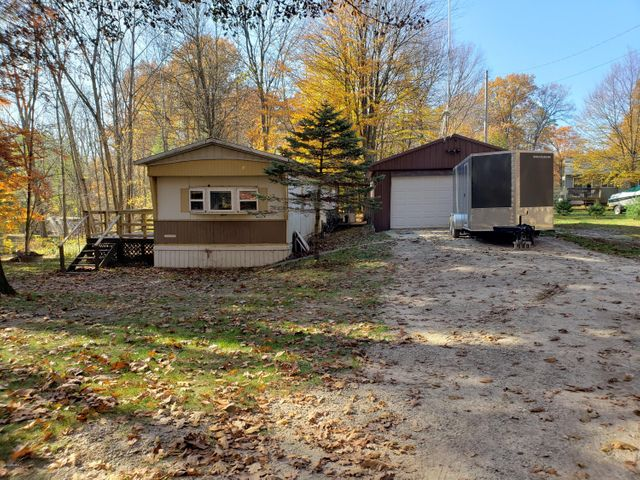 Wonderful opportunity to have shared private lake access.  New well in 5/2019, New Septic in 2017, New Front door with storm door, new flashing on eves, new deck,  Manual Generator Port in summer of 2020 per seller. This little Gem would be a great year round home, vacation home or income property.  Please no letters or photos to accompany offers.  All information on listing card to be verified by buyer and buyers agent.