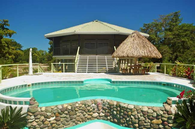 Single Family 3 Bedroom, 2.5 Bathroom, Beachfront home with Swimming Pool and private Dock with covered Boat Slip on a 0.311 acre Lot located at the South Shore of Utila.