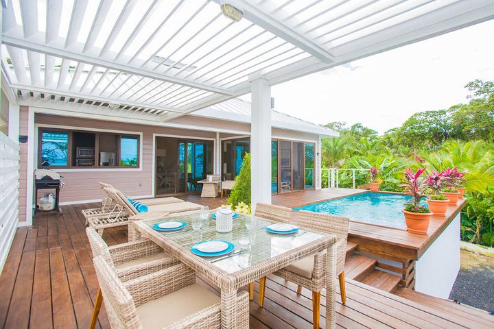 This stunning outdoor living space includes a plunge pool and outdoor eating area