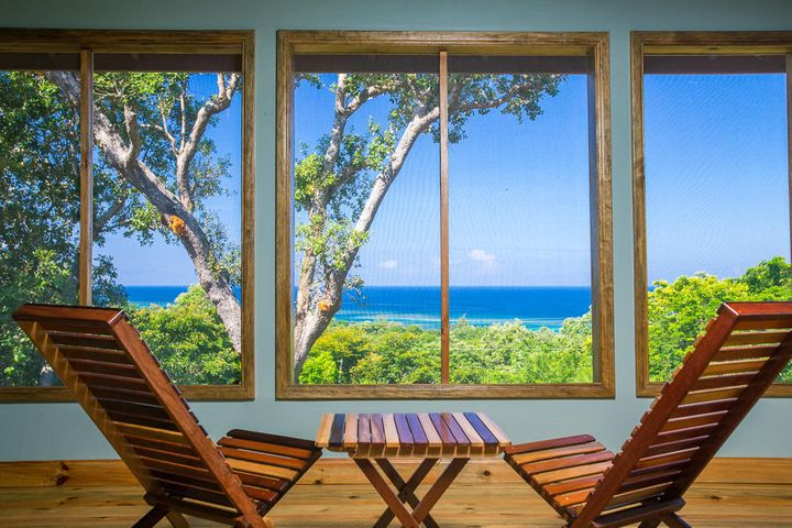 screen porch with ocean view