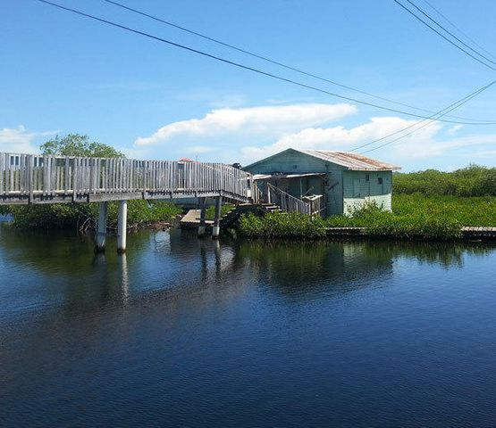 Lagoon front safe harbor lot and house. Value is in the land.