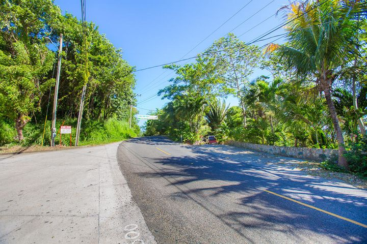 This property boarder the new paved highway to West Bay