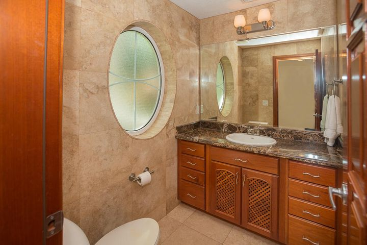 Guest bathroom is located at the entrance of the condo