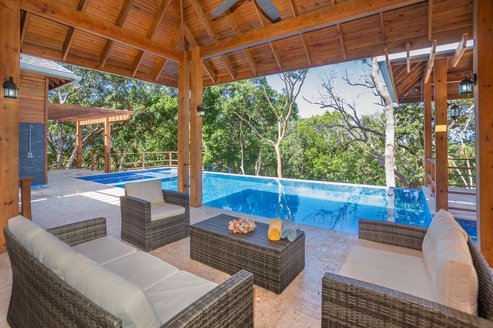 This spacious outdoor living space includes a covered living area