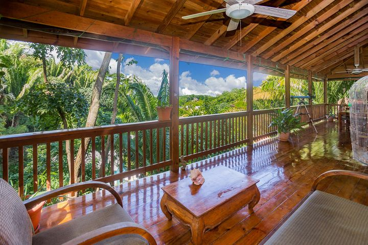 Enjoy ocean views while being surrounded by lush tropical garden on your front porch