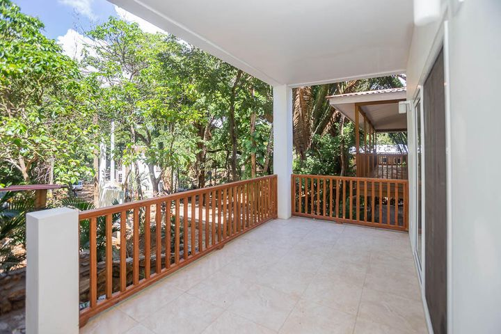 Spacious private patio on condo B1 that overlooks an Avocado Tree and other tropical trees