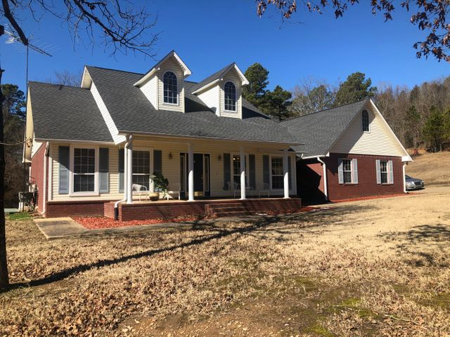 First Time Offered! Oak Valley Farm less than 10 minute drive from downtown Dover, AR. Oak Valley Farm features 46 acres of complete peace and tranquility. Meticulously developed over the last 20 years, including natural springs flowing into deep man-made ponds.  Open wildlife food plots traverses by stately stands of grand oaks. Over a quarter mile road frontage and you're the only one there. Nearly 2000 square feet of spacious quality construction.  Open Floor Plan and a deck designed around the natural atmosphere that makes Oak Valley Farm a special place in God's great landscape. $450,000