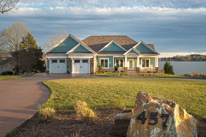This custom built home sits on a wonderful waterfront lot with a southrn exspoure looking at Smith Mountain and a long water view