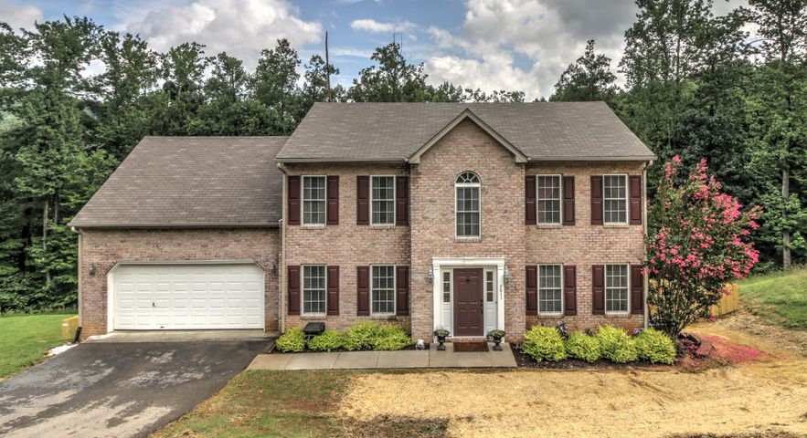 This beautifully appointed brick colonial boasts a spacious open design.