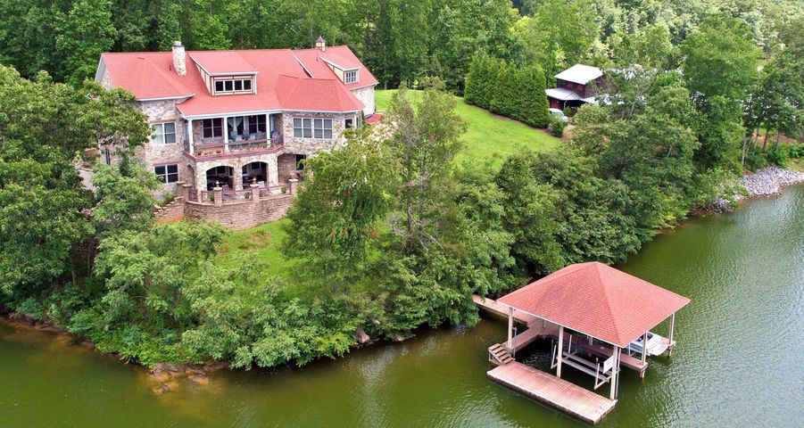 Aerial waterfront shot of house
