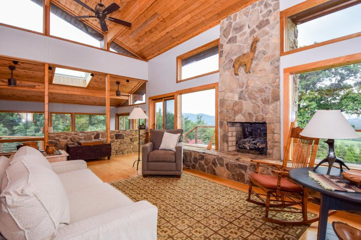 Gas log fireplace in living room with incredible mountian view