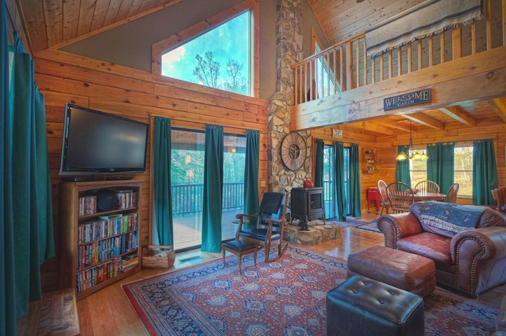 Great Room opens up on to outside deck overlooking lake.