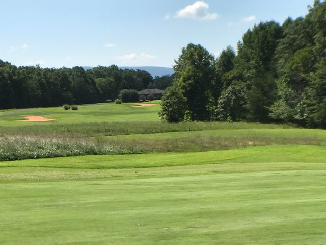 Nestled on the 17th green with long views down the 18th fairway to the club house. Beautiful smith mountain in the background