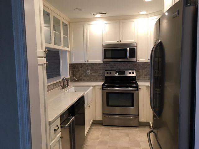 Stainless steel appliances, quartz counter tops.