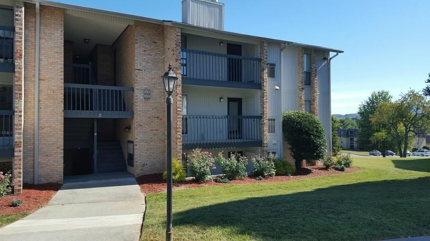 Desirable third floor End unit location , attractive landscaping .