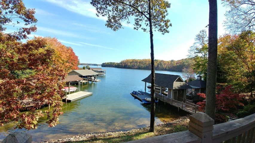Located on a serene large cove with long lake views yet easy access to all major retail