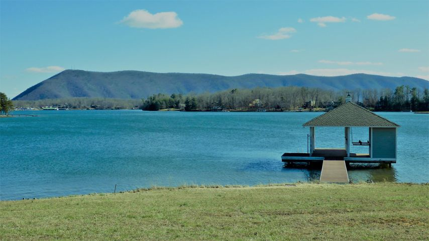 Level Lake Lot with Awesome Mountain Views , Covered Boathouse, Well & Septic Drainfield, Already Excavated and ready for your new home!