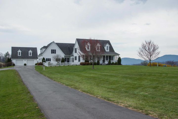Gorgeous custom home on 6.4 acres with endless views.