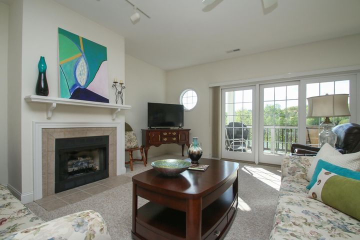 Great room with gas log fireplace opens onto the deck overlooking the lake