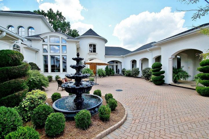 This private spacious gives entrance to the 8,600 square-foot main estate. courtyard