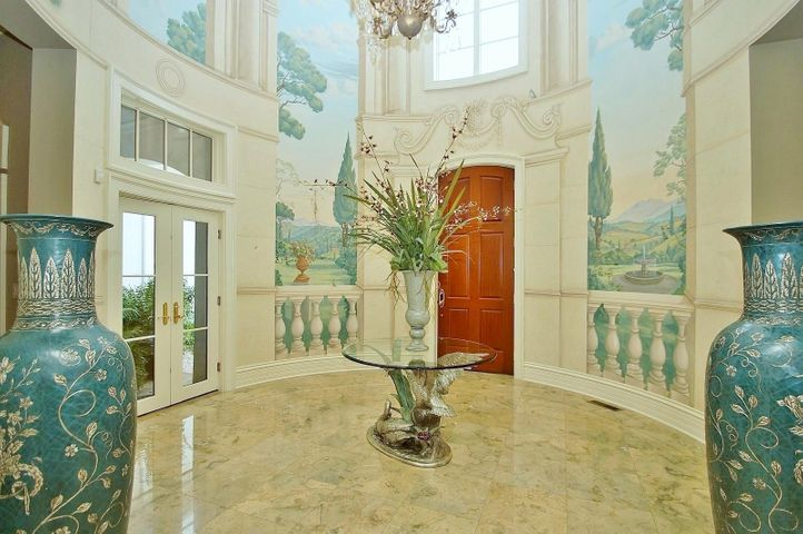 The remarkabley appointed first floor begins with a dramatic formal arched entryway with a 16-foot ceiling rotunda hand-painted by Paul Montgomery of Churchville, Va.
