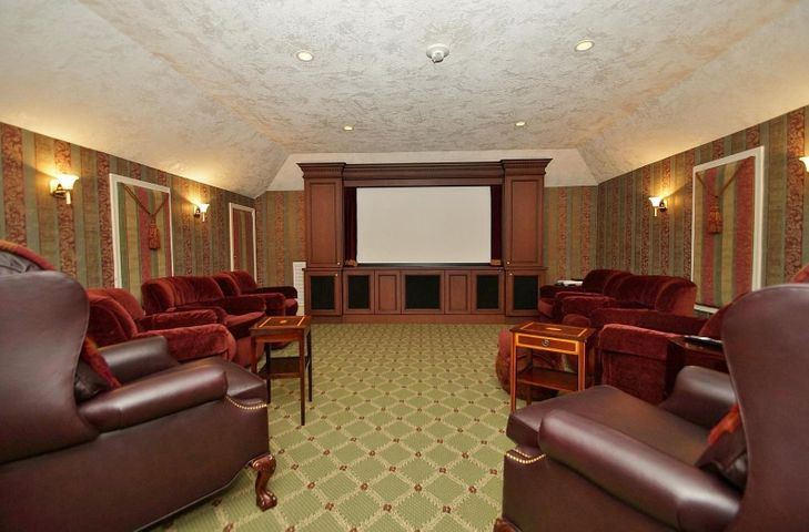 The Home theatre has plenty of comfortable seating, kitchenette, 1/2 bath