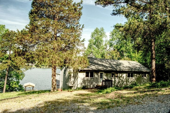 Front of house showing dock and lake view