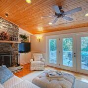 Enjoy family time in this great room with a fireplace.