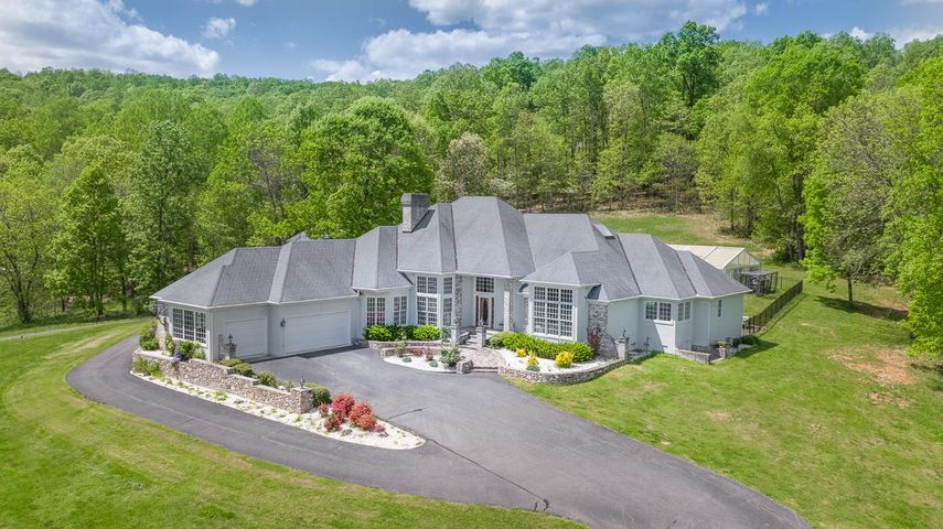 wooded boundary offers peace, privacy & mesmerizing mountain views