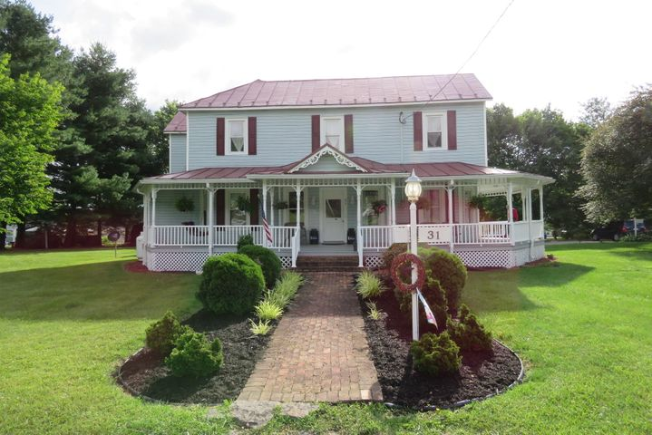 Stunning home!Large wraparound porch on 3 sides!