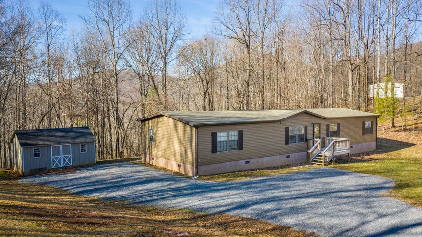 open floor plan on a private 1.41 acre wooded lot.