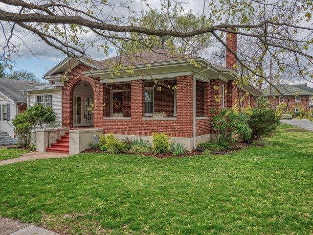 Charming brick Bungalow home in highly sought-after Raleigh Court!