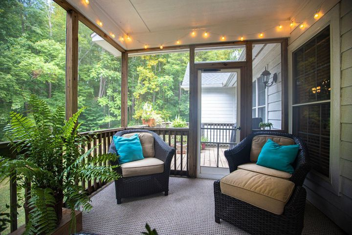 The great screen porch is just off the great room and dining area