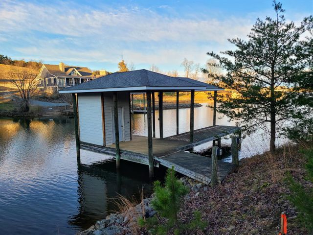waterfront lot with covered dock and storage room
