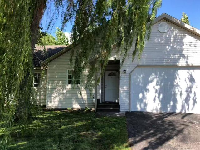 West facing front door with plenty of shade! 2 car garage with extra space for RV parking.