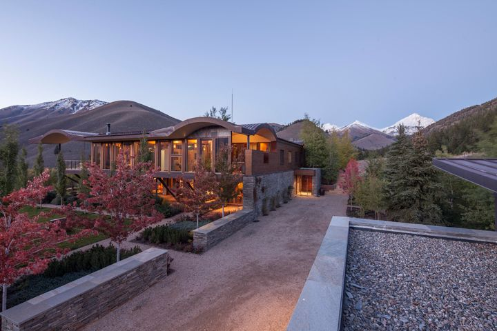 Main House with Mountain Views on skyline.