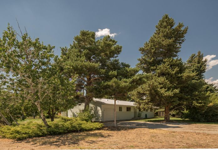 A corner lot with exceptional privacy provided by the mature landscaping