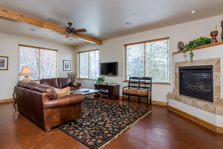 Concrete, heated floors, gas fireplace, light and bright with mountain views