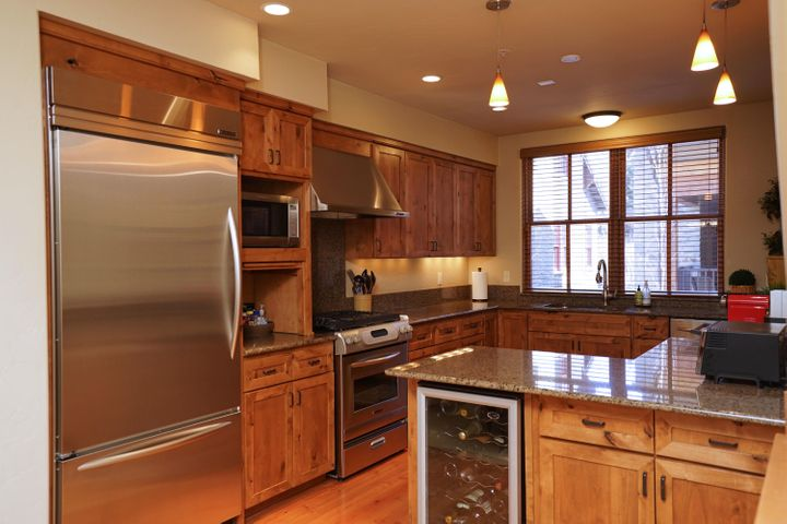 Stainless appliances, granite counter tops, wine refrigerator.
