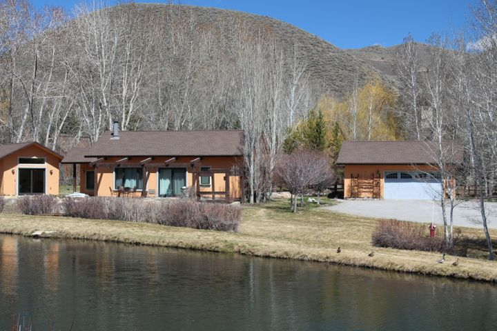 Single level home on two acres with wonderful stream fed pond