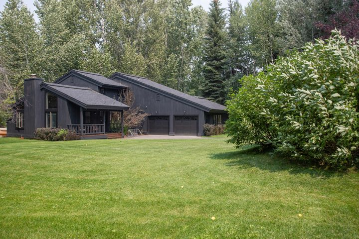 On a spacious lot just under a half acre.