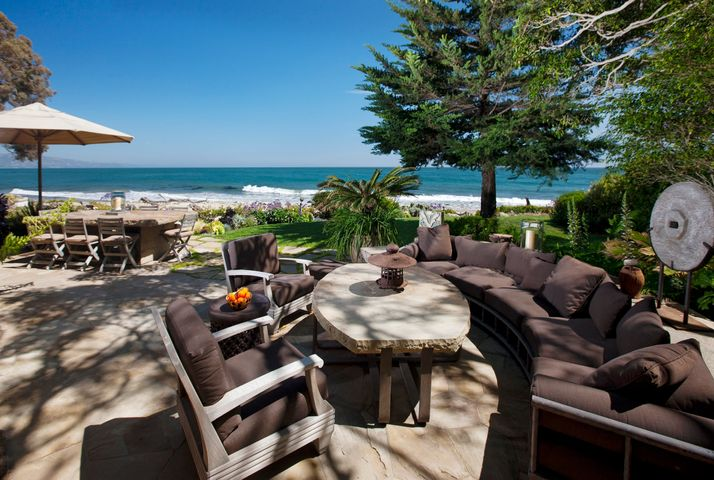 On sand in the heart of Montecito. Living Room and Family Room both extend to beach-side Terrace
