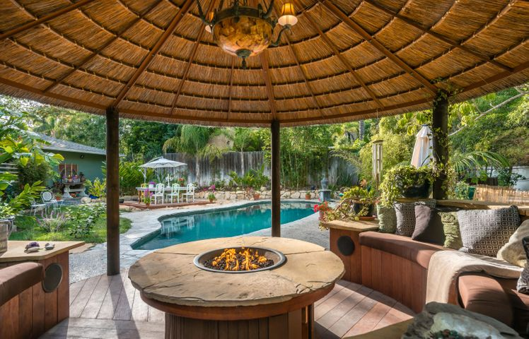Entertain or just kick back in this stunning palapa with firepit and room for 20 friends