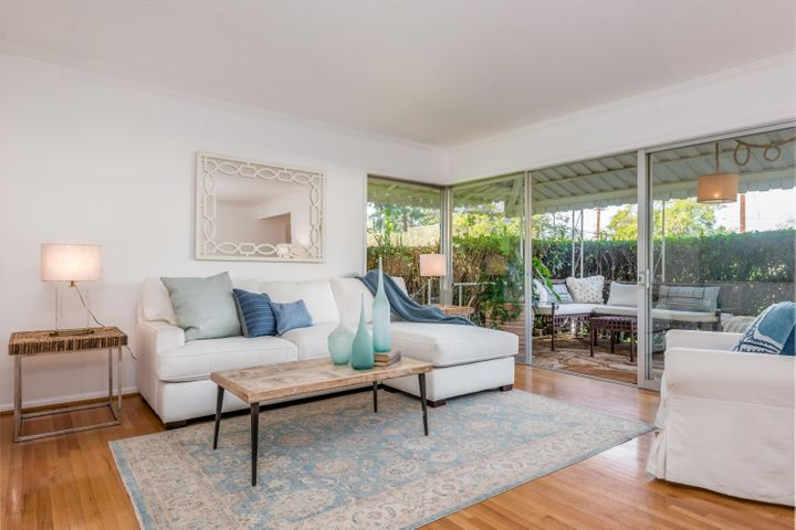 Spacious living room opens outdoors to the intimate front patio