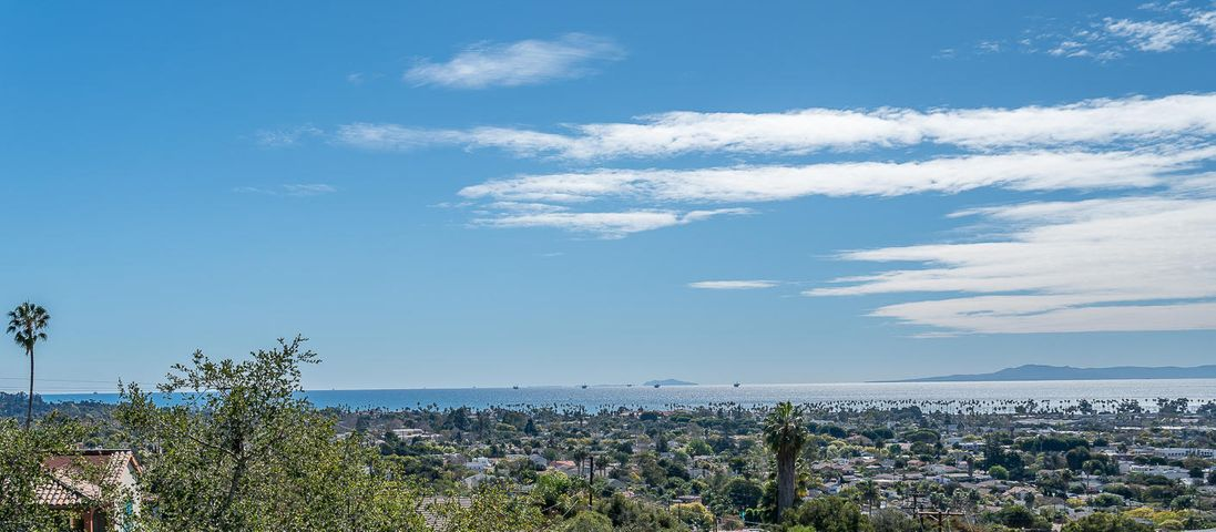 Enjoy panoramic ocean-island-city views from this single level, ranch style home, located in a cul-de-sac on the Lower Riviera.